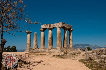 Ruins of Appollo Temple with Fortressat Back in Ancient Corinth, Peloponnese